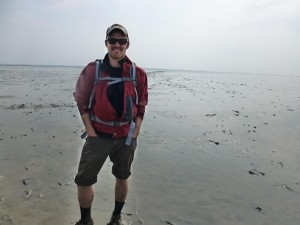 Sundberg standing in the middle of the Waddenzee, an intertidal zone along the northern coast of the Netherlands.