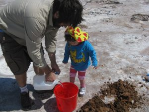 Craig Marshall and his daughter collecting gypsum crystals in Oklahoma.