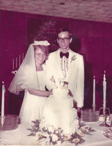 Clyde and Nancy Toland at their wedding celebration in Watkins Room of the Kansas Union.