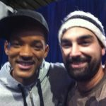 A selfie of Barry wearing a white beanie hat and actor Will Smith wearing a black baseball cap