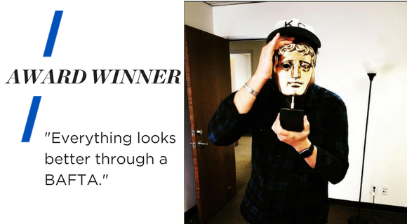 """Image shows Barry holding a gold mask award, a BAFTA, in front of his face. Text reads """"Award Winner. Everything looks better through a BAFTA."""""""
